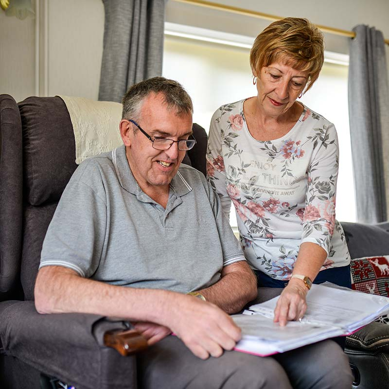 Home Care clients Roy and Diane going through care plan