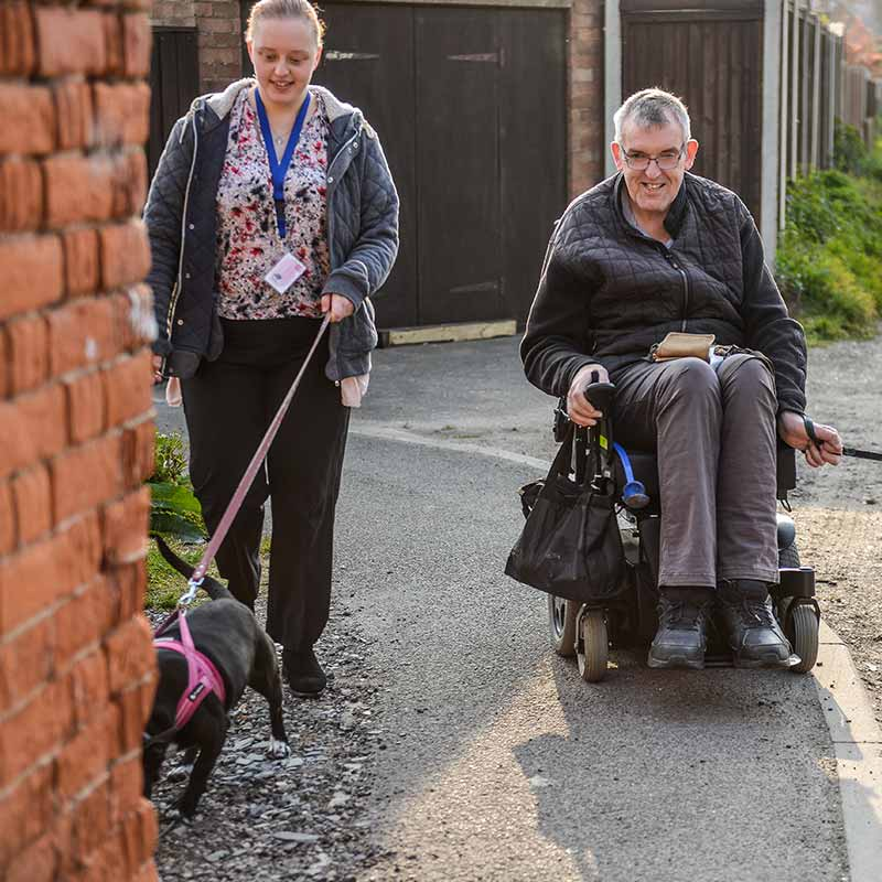 Home Care Assistant Amy walking dogs with Roy at The Great Care Company