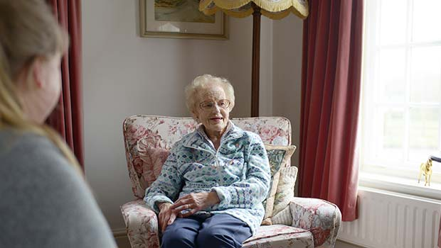 Home Carer and Client sitting down