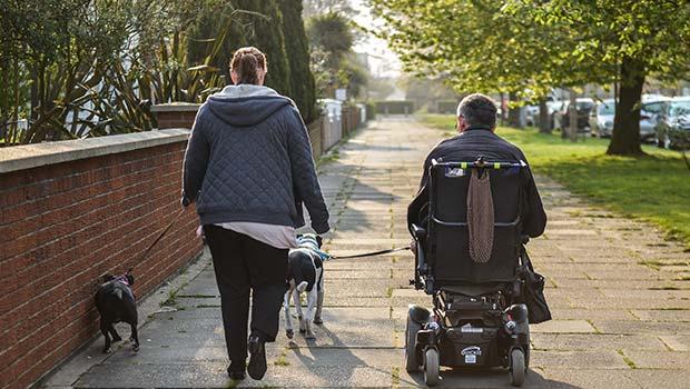 Home carer walking dog