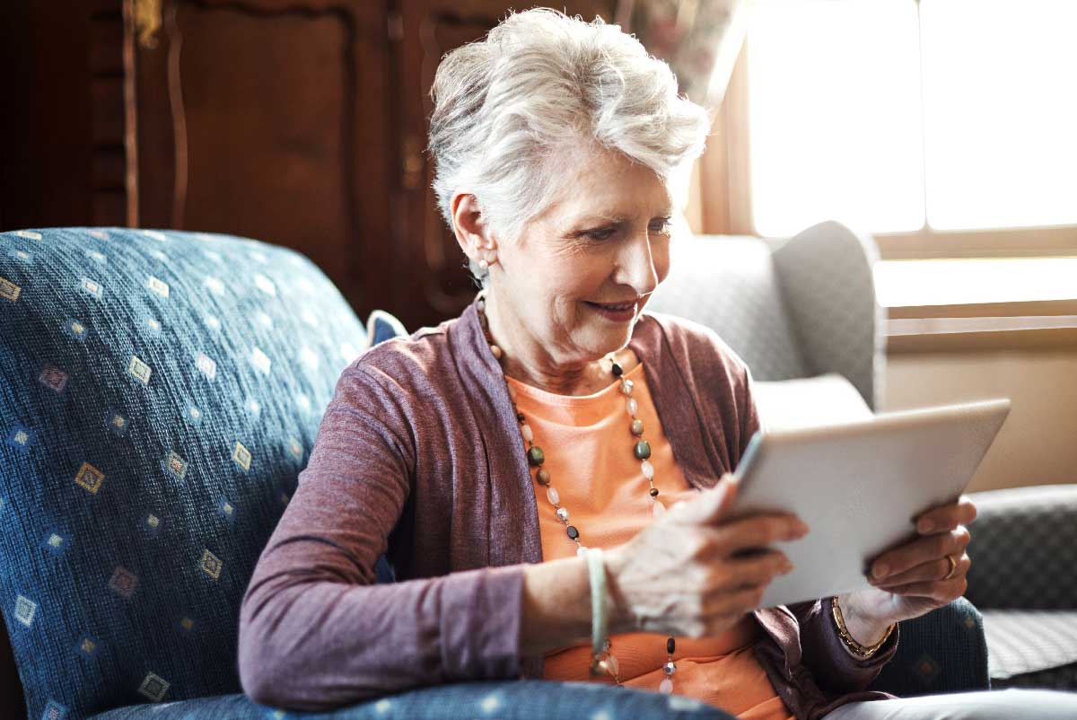 lady on tablet reducing social isolation and lonliness