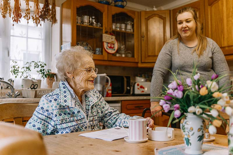 Client and carer from the Great Care Company sitting in kitchen