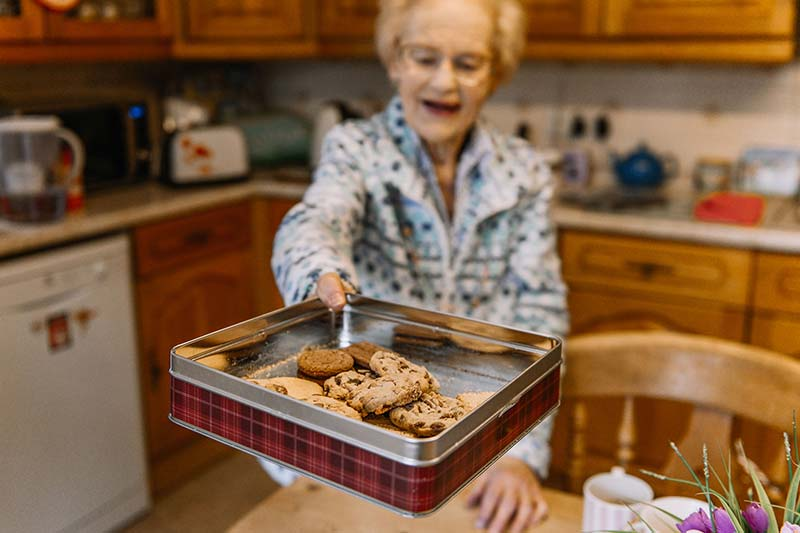A client of the Great Care Company offering cookies baked from the extra mile